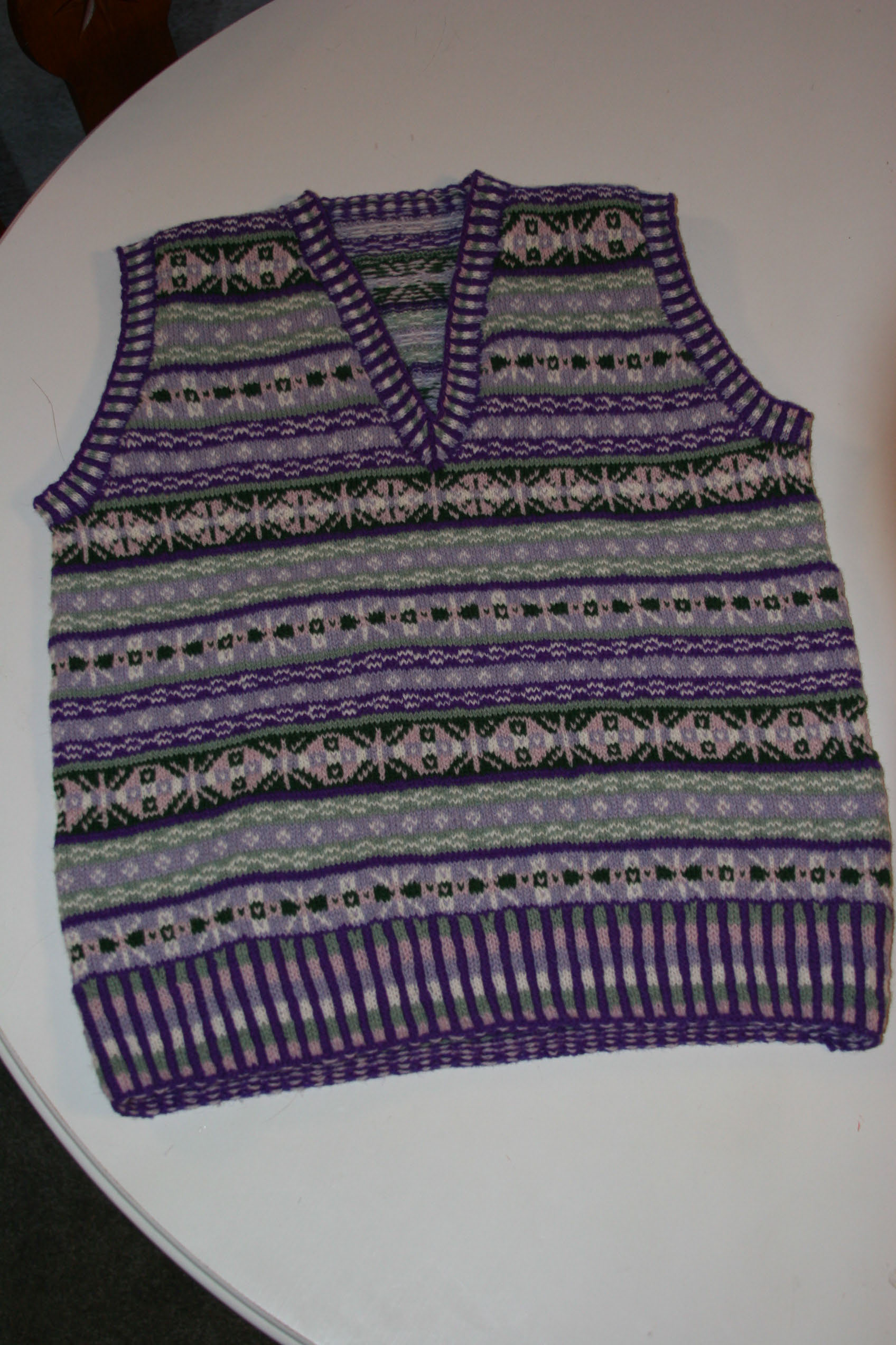 """Purple Fair Isle Vest – The Art of Fair Isle Knitting by Ann Feitelson – """"Hillhead Slipover"""" knitted in Jamieson and Smith Shetland wool in blues, grays, and black."""